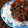 Maria's Pepper Steak Recipe - This recipe - flank steak and vegetables cooked in a mixture of soy sauce, honey, and red wine vinegar - makes a great meal served over rice.