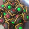 Chocolate Pretzel Treats Recipe - Have the kids help make these fun chocolate pretzels treats with just three simple ingredients: pretzels, candy kisses, and candy-coated chocolate pieces.
