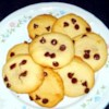 World's Greatest Chewy Chocolate Chip Cookies Recipe - This cookie dough isn't as dry as other cookie doughs, which makes it spread out more in the oven. Plus, they are just the right chewiness. Mmmmm ...