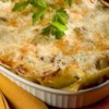 Vegetarian Four Cheese Lasagna Recipe - Fresh pasta sheets baked with ricotta, feta, eggplant, tomato, pesto, pumpkin, Parmesan and mozzarella.