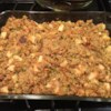 Apple Pecan Cornbread Dressing Recipe - Savory, yet sweet, this cornbread dressing will satisfy anyone's appetite. Two teaspoons of dried parsley flakes can be substituted for fresh parsley.