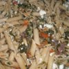 Mostaccioli with Spinach and Feta Recipe - Flavorful feta cheese, studded with bits of tomato and basil, is tossed with hot pasta into a saute of fresh tomatoes, baby spinach and minced garlic for a colorful, aromatic meal.