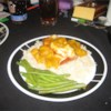 Salmon with Mango and Brie Recipe - Seared salmon fillets are baked with Brie and topped with a mango sauce.