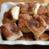 Sopapilla Cheesecake Pie Recipe and Video - I make this cinnamon and vanilla cheesecake to take to pot luck dinners and get rave reviews!  Easy to make, smells great while cooking and tastes wonderful!
