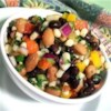 Best-Ever Texas Caviar Recipe - This version of Texas caviar mixes black beans and pinto beans instead of black-eyed peas with jalapeno peppers, cilantro, red onion and bell peppers. Serve with scoop-style tortilla chips to make a zesty crowd-pleasing party appetizer.