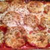 Baked Eggplant Parmesan Recipe - Eggplant slices are coated with bread crumbs and Parmesan cheese and baked between layers of tomato sauce and mozzarella cheese for a filling Italian-inspired meal.