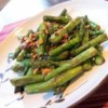 Asparagus and Cashews Recipe - Crispy asparagus spears are stir-fried with ginger and cashews.