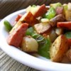 Kielbasa with Peppers and Potatoes Recipe - Kielbasa cooked with red and yellow peppers and potatoes.