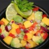 Avocado Mango Salsa Recipe and Video - Yowzers!  Sweet and hot salsa with tangy mangoes and habaneros. Great with pork, chicken or fish or just with chips.  You can omit the habaneros and add red bell peppers for a non-spicy version, but then again, why would you want to? Remember, ALWAYS wear gloves when working with habaneros!