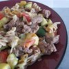 Cheesy Sausage Zucchini Casserole Recipe - My mom would make this recipe with the zucchini and tomatoes that would flourish in our garden.  It's my favorite casserole.