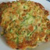 Easy Zucchini Fritters Recipe - These cheesy zucchini fritters are unbelievably easy to make and the perfect way to sneak some veggies into dinner!