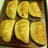 Sloppy Joe Pockets Recipe - A little pastry triangle made of refrigerated biscuit dough encloses a tangy sloppy joe filling. It's a snack, it's a little meal for the kids, it's an appetizer.