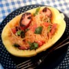 Paleo Spaghetti Squash Recipe - Spaghetti squash is roasted and served with sausage and a tomato sauce in this recipe for a delicious paleo-friendly meal.