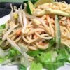 Thai Noodle Salad Recipe - Udon noodles are cooked and combined with cucumbers, sprouts, green onions, carrot and lots of freshly chopped mint. Then everything is tossed with a spicy ginger/peanut sauce and garnished with roasted peanuts. Makes six generous servings.