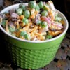 Yummy Summer Pea Salad Recipe - Use frozen peas, shredded Cheddar cheese, and cooked bacon to make a quick and tasty pea salad that is perfect for summertime eating.