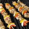 Chicken and Bacon Shish Kabobs Recipe - Marinated mushrooms and bacon-wrapped chicken chunks are threaded onto skewers with pineapple, and cooked on the grill.