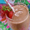Strawberry Kiwi Smoothie Recipe - This strawberry-kiwi smoothie gets a tart kick from orange juice and a little extra sweetness from honey. Perfect for any time of day.