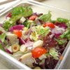 Classic Tossed Salad Recipe - Having two different lettuces, Romaine and red leaf,  is a nice touch in this hearty tossed salad. And there's a nice balance of soft and crunchy: tomatoes and mushrooms to sesame seeds and almonds. Colorful too.