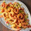 Grilled BBQ Shrimp with Citrus Corn Salad Recipe - Marinated shrimp grilled in foil packets with barbeque sauce are served with a colorful and refreshing citrus corn salad.