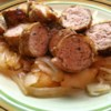 Grilled Sausages with Caramelized Onions and Apples Recipe - Apples, onions, and grilled sausages make a perfect cool-weather meal. Serve with boiled or roasted new potatoes, a mix of fresh vegetables, and some warm crusty bread!