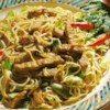 Indonesian Pork Noodle Bowl Recipe - Marinated strips of pork loin are stir fried with cabbage, celery, garlic, and vermicelli pasta.