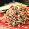 Cold Szechuan Noodles and Shredded Vegetables Recipe - Japanese soba noodles are marinated in tamari, sesame oil, rice wine vinegar, white sugar and chili oil, then tossed with julienned carrots and red bell peppers for a delicious cold salad with an Asian flair.