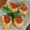 Open Face Mozzarella Sandwich Recipe - The time-honored flavors of basil, tomato, and mozzarella are baked on Italian bread for a quick but elegant melted cheese sandwich. Add a glass of wine or a cup of soup for the perfect light summery lunch.