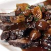 Braised Beef Short Ribs Recipe - A savory stew including tomatoes, potatoes, carrots, and garlic. This very flavorful and economical cut of meat requires long, slow cooking.