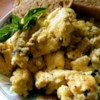 Creamy Cheesy Scrambled Eggs with Basil Recipe - Sour cream makes these eggs rich and creamy, and the basil adds a little kick of flavor.