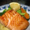 Lime-Marinated Grilled Salmon Recipe - The fresh lime juice and mustard add a nice tang to this moist and flaky grilled salmon. I came up with this marinade after tasting something similar at a friend's house and it is now one of our favorite ways to do fish. You may also use other firm fish steaks instead of salmon; halibut, tuna and swordfish all work well.