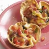Antojitos Minis Recipe and Video - These little Mexican inspired appetizers are easy to prepare and the many ingredients may be varied according to taste. Try layering the cheeses and vegetables in different variations for a colorful and exciting platter.