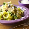 Pesto Spaghetti Squash Recipe - Baked spaghetti squash is combined with onions, mushrooms, and kale, then seasoned with delicious prepared pesto sauce to make hearty side dish or a comforting vegetarian main dish.