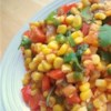 Mexican Corn Salad Recipe - All the veggies in this salad  - fresh corn, peppers, zucchini and onions  - are chopped or diced, so the consistency is very much like salsa. Everything is sauteed in butter and then chilled, until ready to spoon onto a salad or into a warm tortilla with a dollop of sour cream.