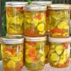 Bread and Butter Pickles II Recipe and Video - Cucumber slices, onions, peppers and garlic are pickled in an exciting spicy cider vinegar mixture! What a great way to end the summer!