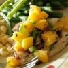 Grilled Tilapia with Mango Salsa Recipe and Video - Don't let the list of ingredients fool you: this is super-easy, and gets rave reviews whenever I serve it. The salsa can be made the day ahead to save time.