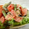 Asparagus and Tomato Salad with Yogurt-Cheese Dressing Recipe -  Yogurt, Parmesan cheese and mustard. Unlikely companions you 'd think, but they produce a quite remarkable dressing. Perfect for spooning on asparagus, tomatoes and sliced green onions.
