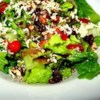 Blue Cheese and Dried Cranberry Tossed Salad Recipe - This salad is a tried and true crowd pleaser. A basic romaine salad is dressed up with toasted pecans, cranberries, and crumbled blue cheese and tossed with balsamic vinaigrette to serve. Make this an easy meal by adding grilled chicken and serving with a crusty baguette.