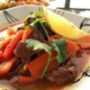 Lamb Tagine Recipe and Video - This is a traditional Moroccan lamb tagine simmered in numerous spices.  Don't let the long ingredients list put you off.  If you are missing one or two the dish will still turn out fine.