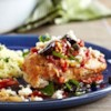 Pan-Seared Mediterranean Chicken Recipe - You will get all the flavors of the Mediterranean in this dish featuring pan-seared chicken breasts in a sauce made with sun-dried tomatoes, chicken stock, garlic and lemon. Topped with olives.