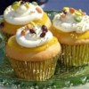 Maharani Cupcakes Recipe - These coconut cupcakes with curry lemon curd and a sweet basil cream topping are regal enough for a queen! They take time to create, but the end result is worth it.