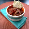 Minnesota Golf Course Chili Recipe - Ground beef is simmered with bell pepper, garlic, tomatoes, kidney beans and chili powder in this easy chili.