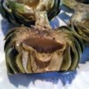 Grilled Garlic Artichokes Recipe - No more dipping artichokes in mayo! These artichokes are grilled with a lemon garlic basting sauce. This is the best way to eat artichokes.