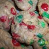 Delicious Christmas Cookies Recipe - This family recipe combines graham cracker crumbs, flour, sweetened condensed milk, butter, coconut and candy-coated chocolates.  They just might become a tradition in your family too!