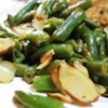 Lemon Pepper Green Beans Recipe - Green beans are tossed with almonds which have been sauteed in butter with lemon pepper.
