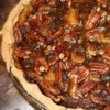 Caramel-Pecan Pumpkin Pie Recipe - Enjoy Thanksgiving's favorite flavors in this easy-to-make pie that combines a pumpkin filling accented with lemon zest, and a caramelized brown sugar-pecan topping.