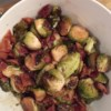 Maple Roasted Brussels Sprouts with Bacon Recipe and Video - Brussels sprouts are roasted with bacon, maple syrup, and olive oil for a smokey, caramelized side dish.