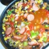 Sassy Sausage and Black Bean Soup Recipe - This hearty soup is made with canned black beans, salsa and tomatoes cooked in beef broth with slices of hot beef sausage.
