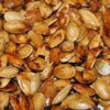 Sweet and Spicy Pumpkin Seeds Recipe - Butter, salt, Worcestershire sauce, brown sugar, and hot sauce are all you need to spice up your pumpkin seed haul from Halloween decorating or any fall cooking involving pumpkins.