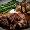 Beef Tenderloin With Roasted Shallots Recipe - This tenderloin roast makes a good company dinner. It is similar to Beef Bourguignon, but requires considerably less cooking time. Roasted shallots are added to the sauce along with sauteed bacon bits. The recipe serves 6 and can be doubled.