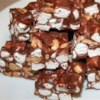 Rocky Road Candies Recipe - It couldn't be easier to make this treat.  Just melt chocolate chips and stir in peanuts and marshmallows.